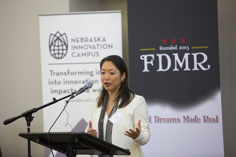 Suji Park, founder of Food Dreams Made Real, delivers remarks Monday at Nebraska Innovation Campus. Her company, Suji's Cuisine USA, a producer of South Korean prepared meals, is opening an office at the campus for research and development.