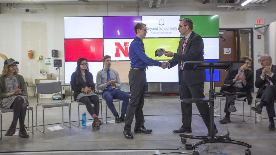 Chancellor Ronnie Green congratulates Caleb Kowalski on his selection as an inaugural Innovation Fellow Monday at Nebraska Innovation Studio.
