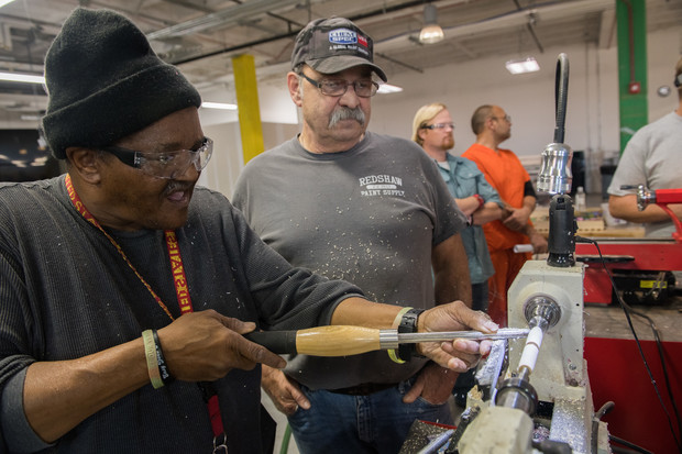 David Key and Richard Schaefer work on a lathe at Nebraska Innovation Studio during a Veterans in Recovery meeting.