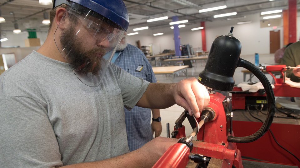 Bryan Jones of Lincoln, a veteran of the United States Navy, uses a lathe in Nebraska Innovation Studio.
