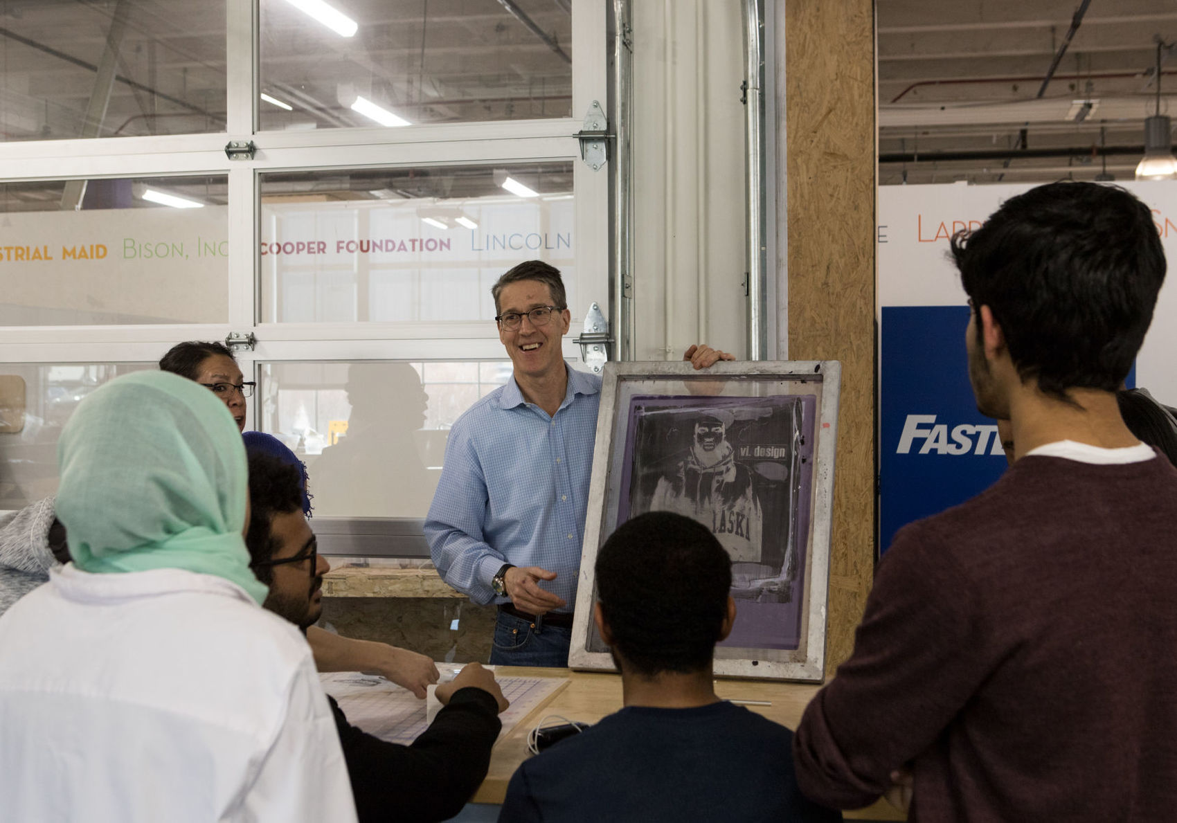 David Martin, director of Nebraska Innovation Studios, explains screen printing to students in the Intensive English Program on March 1, 2018, at Nebraska Innovation Campus in Lincoln, Nebraska.
