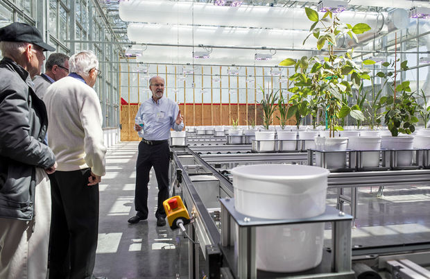 Agronomy and horticulture professor Daniel Schachtman gives a tour of the greenhouse and newly installed LemnaTec plant phenotyping system Monday at Nebraska Innovation Campus.