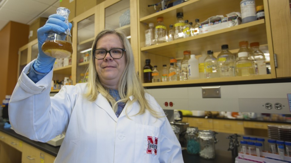 Nebraska's Heather Hallen-Adams holds a beaker of the yeast she helped identify for Lincoln's Boiler Brewing Company. The yeast was used to brew Nebraska Native, an American wild ale and the first commercially available craft beer made only from Nebraska ingredients.