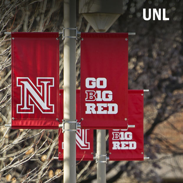 UNL Go B1G Red flags line downtown streets