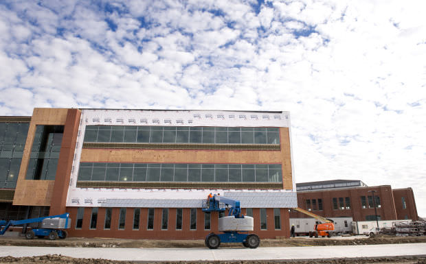 Work continues on the companion building (left) to the old 4-H building on Innovation Campus on Thursday.