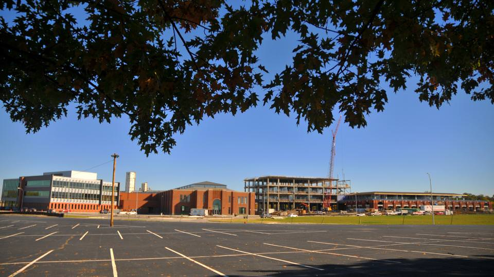 Construction at Nebraska Innovation Campus continues with work on the Food Innovation Center (right). Completed buildings include Innovation Commons (left), which includes the former Nebraska State Fair 4-H Building. The Food Innovation Center includes the former Industrial Arts Building.