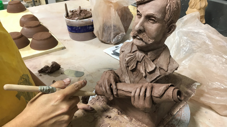 A bust of Nebraska architect Thomas Kimball takes shape in Nebraska Innovation Studio. The bust was being done by artist David Manzanares, who utilities the studio to create his sculptures. He also teaches workshops for fellow studio members.