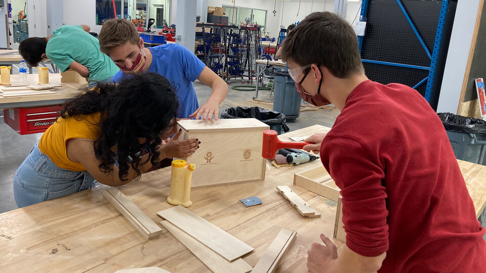 Students assemble toolboxes in Nebraska Innovation Studio on Oct. 17. The boxes will be given to the Whiteclay Makerspace.
